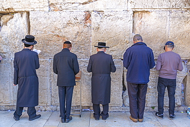 View of worshippers at the Western Wall in Old City, Old City, UNESCO World Heritage Site, Jerusalem, Israel, Middle East