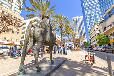 View of statue, palm trees and walkway on Rothschild Boulevard, Tel Aviv, Israel, Middle East