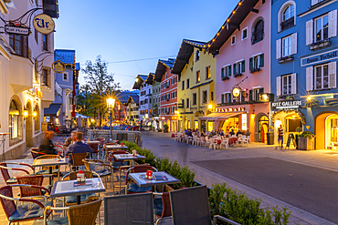 View of architecture and cafes on Vorderstadt at dusk, Kitzbuhel, Austrian Tyrol Region, Austria, Europe