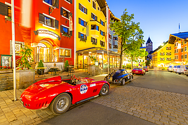 View of architecture and classic car on Vorderstadt at dusk, Kitzbuhel, Austrian Tyrol Region, Austria, Europe