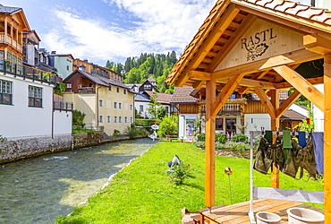 View of colourful buildings and river in Bad Aussie, Styria, Austria, Europe