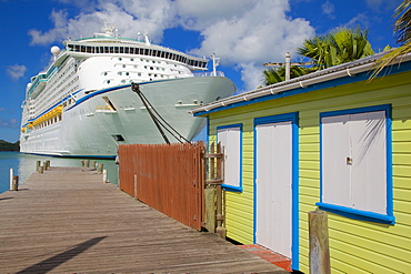 Colourful building and cruise ship in port, St. Johns, Antigua, Leeward Islands, West Indies, Caribbean, Central America