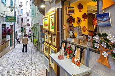 View of local souvenirs on cobbled street in the old town, Rovinj, Istria, Croatia, Adriatic, Europe