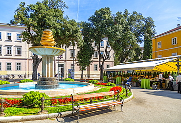 View of cafes and water fountain in Dante Square, Pula, Istria County, Croatia, Adriatic, Europe