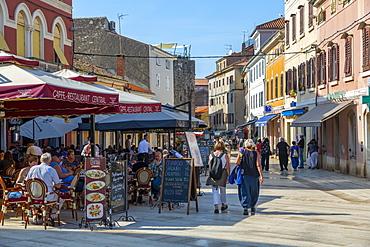 View of cafe restaurant on Trg Slobode, old town, Porec, Istria, Croatia, Europe