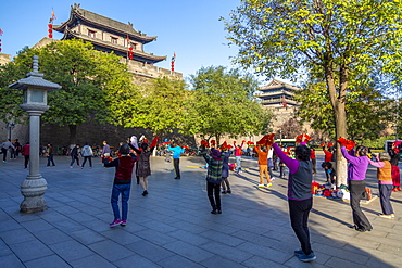 Locals performing Tai chi near City wall of Xi'an, Shaanxi Province, People's Republic of China, Asia