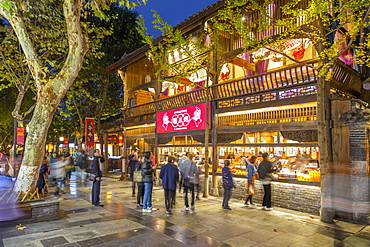 Shoppers in Kuanxiangzi Alley at night, Chengdu, Sichuan Province, People's Republic of China, Asia