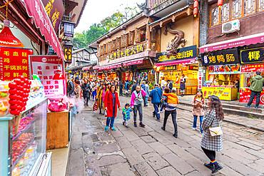 Busy shopping street in Ciqikou Old Town, Shapingba, Chongqing, China, Asia