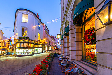 View of shops on London Street at Christmas, Norwich, Norfolk, East Anglia, England, United Kingdom, Europe