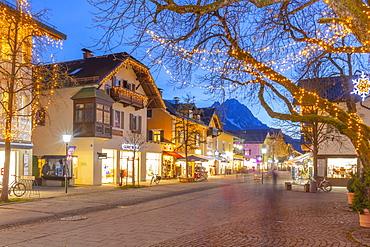 View of town shops at dusk, Garmisch-Partenkirchen, Bavaria, Germany, Europe