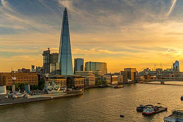View of the Shard, HMS Belfast and river Thames from Cheval Three Quays at sunset, London. Property released for viewpoint - 844-23642