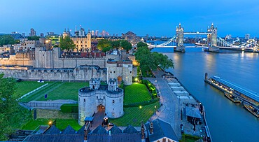 View of Tower Bridge and the Tower of London from Cheval Three Quays at dusk, London. Property released for viewpoint - 844-23647
