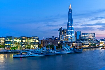 View of the Shard, HMS Belfast and river Thames from Cheval Three Quays at dusk, London. Property released for viewpoint - 844-23648
