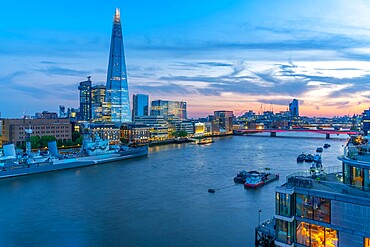View of the Shard, HMS Belfast and river Thames from Cheval Three Quays at dusk, London. Property released for viewpoint - 844-23650