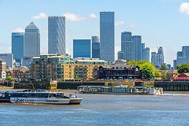 View of Canary Wharf Financial District and taxi boat from the Thames Path, London, England, United Kingdom, Europe - 844-23657