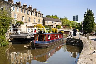 Narrowboat passing a Swing Bridge at Skipton, North Yorkshire, Yorkshire, England, United Kingdom, Europe