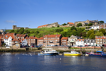 Boats in the Upper Harbour below St. Marys Church, Whitby, North Yorkshire, Yorkshire, England, United Kingdom, Europe