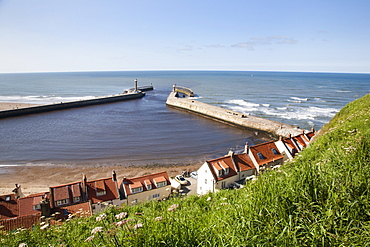 Whitby harbour walls and lighthouses from the clifftop, Whitby, North Yorkshire, Yorkshire, England, United Kingdom, Europe