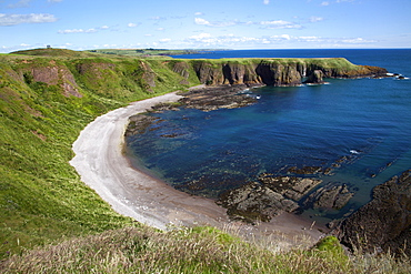Strathlethan Bay with the War Memorial on the clifftop near Stonehaven, Aberdeenshire, Scotland, United Kingdom, Europe