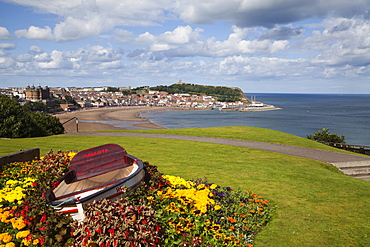 Rowing boat and flower display at South Cliff Gardens, Scarborough, North Yorkshire, Yorkshire, England, United Kingdom, Europe