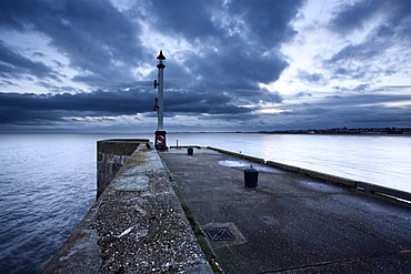 Sea wall and Harbour Light at Bridlington, East Riding of Yorkshire, England, United Kingdom, Europe