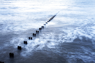 Groynes and incoming tide at Bridlington, East Riding of Yorkshire, England, United Kingdom, Europe