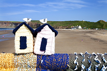 Saltburn Yarn Stormers Knitted Beach Huts on the Pier at Saltburn by the Sea, Redcar and Cleveland, North Yorkshire, Yorkshire, England, United Kingdom, Europe