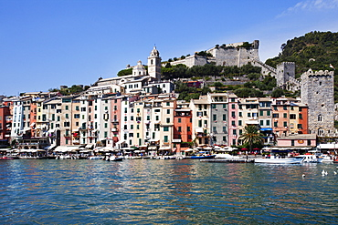 Brightly painted houses and medieval Town Walls by the Marina at Porto Venere, Cinque Terre, UNESCO World Heritage Site, Liguria, Italy, Mediterranean, Europe