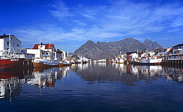 Calm water in the harbour at Henningsvaer in the Lofoten Islands, Norway, Scandinavia, Europe