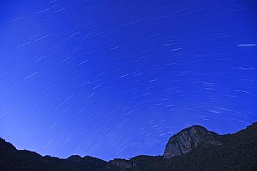 Star trails at dusk above Mount Nyiru, Northern Frontier, Kenya, East Africa, Africa