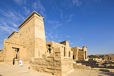 Man in jellabiya by the first pylon and the Gate of Ptolemy at the Temple of Isis, Philae, UNESCO World Heritage Site, Nubia, Egypt, North Africa, Africa