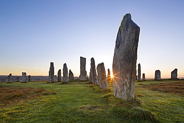The sun rises at Callanish stone circle, Isle of Lewis, Outer Hebrides, Scotland, United Kingdom, Europe