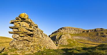 Drystone wall beneath Attermire Scar at sunrise, Settle, North Yorkshire, Yorkshire, England, United Kingdom, Europe