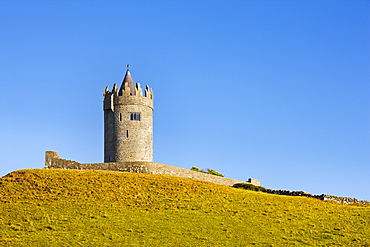 Doonagore Castle between the village of Doolin and the Cliffs of Moher on the County Clare coast, County Clare, Munster, Republic of Ireland, Europe
