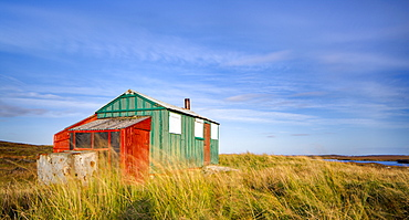 Colourful summer hut (sheiling) on the wind swept moors of the Isle of Lewis, Outer Hebrides, Scotland, United Kingdom, Europe