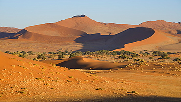 Looking towards the dunes of Sossusvlei, with two tiny figures on the lower ridge of the dune, Namib Naukluft, Namibia, Africa