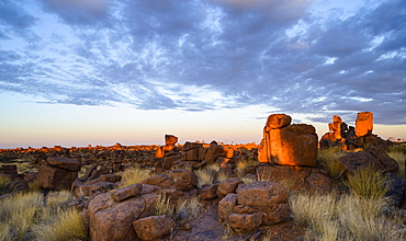 Boulders and grasses at sunrise, Giant's Playground, Keetmanshoop, Namibia, Africa