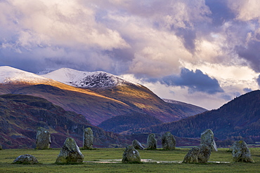 Castlerigg Stone Circle in autumn with the snow topped Helvellyn mountain range in the distance, Lake District National Park, Cumbria, England, United Kingdom, Europe
