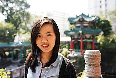 Portrait of young woman, Wong Tai Sin Temple, Kowloon, Hong Kong, China, Asia