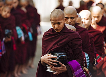 Novice Buddhist monks returning to monastery for their breakfast, Amarapura, Mandalay, Mandalay Region, Myanmar (Burma), Asia