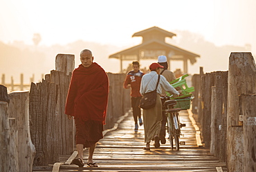 Early morning pedestrian traffic on U-Bein Bridge, Amarapura, Mandalay, Mandalay Region, Myanmar (Burma), Asia