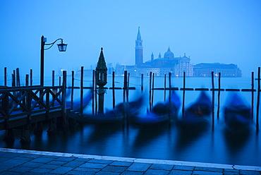 Gondolas on the waterfront of St. Mark's Basin at dawn, Venice, UNESCO World Heritage Site, Veneto Province, Italy, Europe