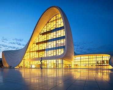 Exterior of Heydar Aliyev Building at night, designed by Zaha Hadid, Baku, Azerbaijan, Central Asia, Asia