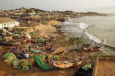 Fishermen with boats at dawn, Cape Coast, Ghana, Africa