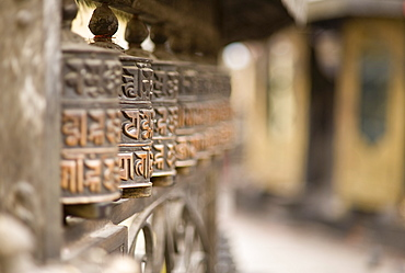Prayer wheels, Swayambhu (Monkey Temple), Kathmandu, Nepal, Asia