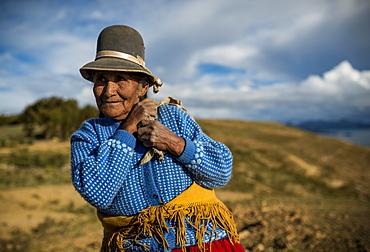 Portrait of local Bolivian woman, Isla del Sol, Lake Titicaca, Bolivia, South America