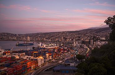 View of city and ports at dusk from Paseo 21 de Mayo, Cerro Playa Ancha, Valparaiso, Central Coast, Chile, South America