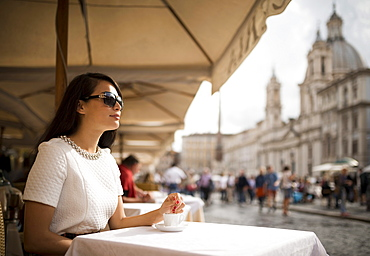 Young woman enjoying Espresso at restaurant, Piazza Navona, Rome, Italy, Europe