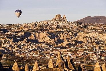 Hot air balloons flying among rock formations at sunrise in the Red Valley, Goreme National Park, UNESCO World Heritage Site, Cappadocia, Anatolia, Turkey, Asia Minor, Eurasia