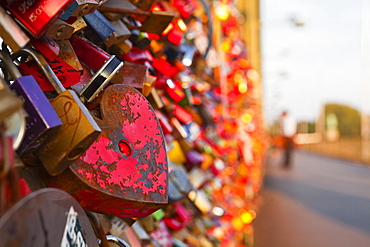 Love locks tied onto the railway bridge in Cologne, North Rhine-Westphalia, Germany, Europe